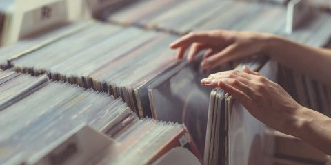 Photo of a person searching through vinyl records