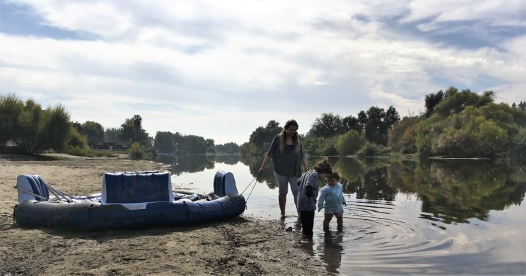 Photo of a mother and her children wading in the Kings River