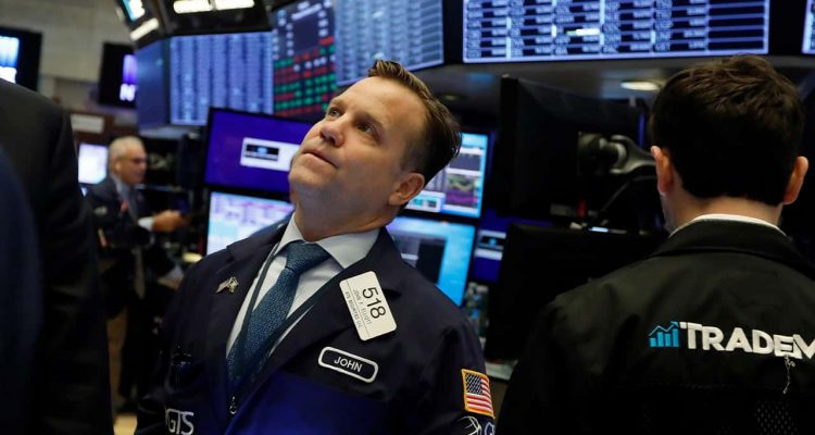 Photo of a trader on the floor of the New York Stock Exchange