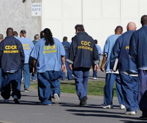 Photo of CDCR prisoners walking through the yard