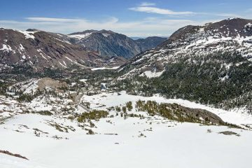 Photo of the view from Gaylor Peak down to the east side of Tioga Pass during winter