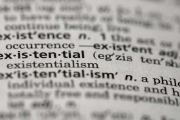 "Photo of the word ""existential"" in a dictionary in the Brooklyn borough of New York"