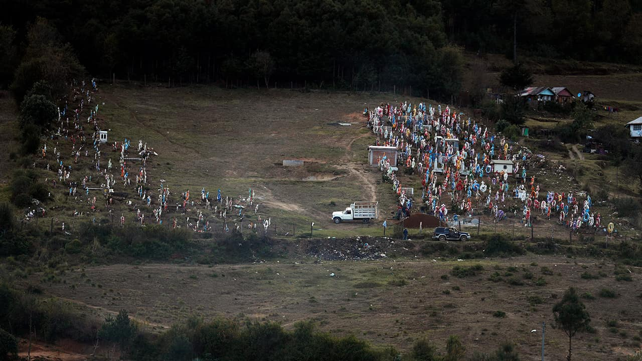 Photo of workers preparing a grave in the cemetery where environmental activist Homero Gomez Gonzalez was to be buried the following day, in Ocampo, Michoacan state, Mexico