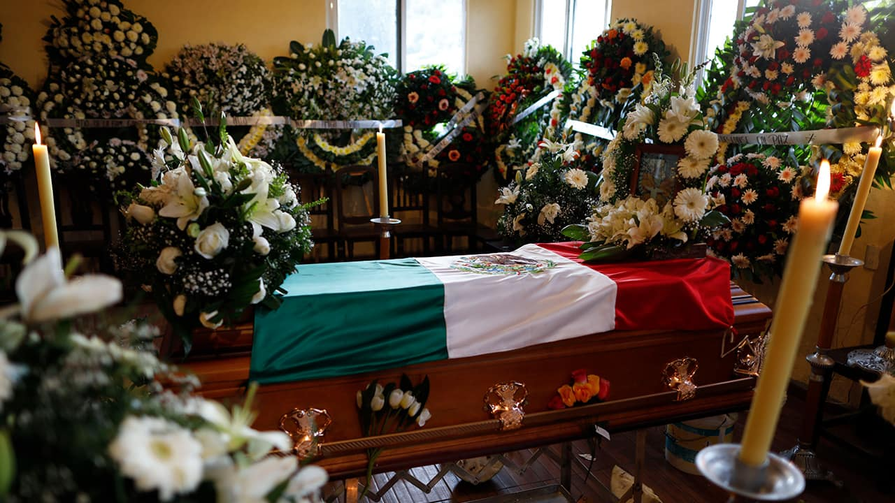 Photo of the flag-draped coffin of environmental activist Homero Gomez Gonzalez at his wake in Ocampo, Michoacan state, Mexico