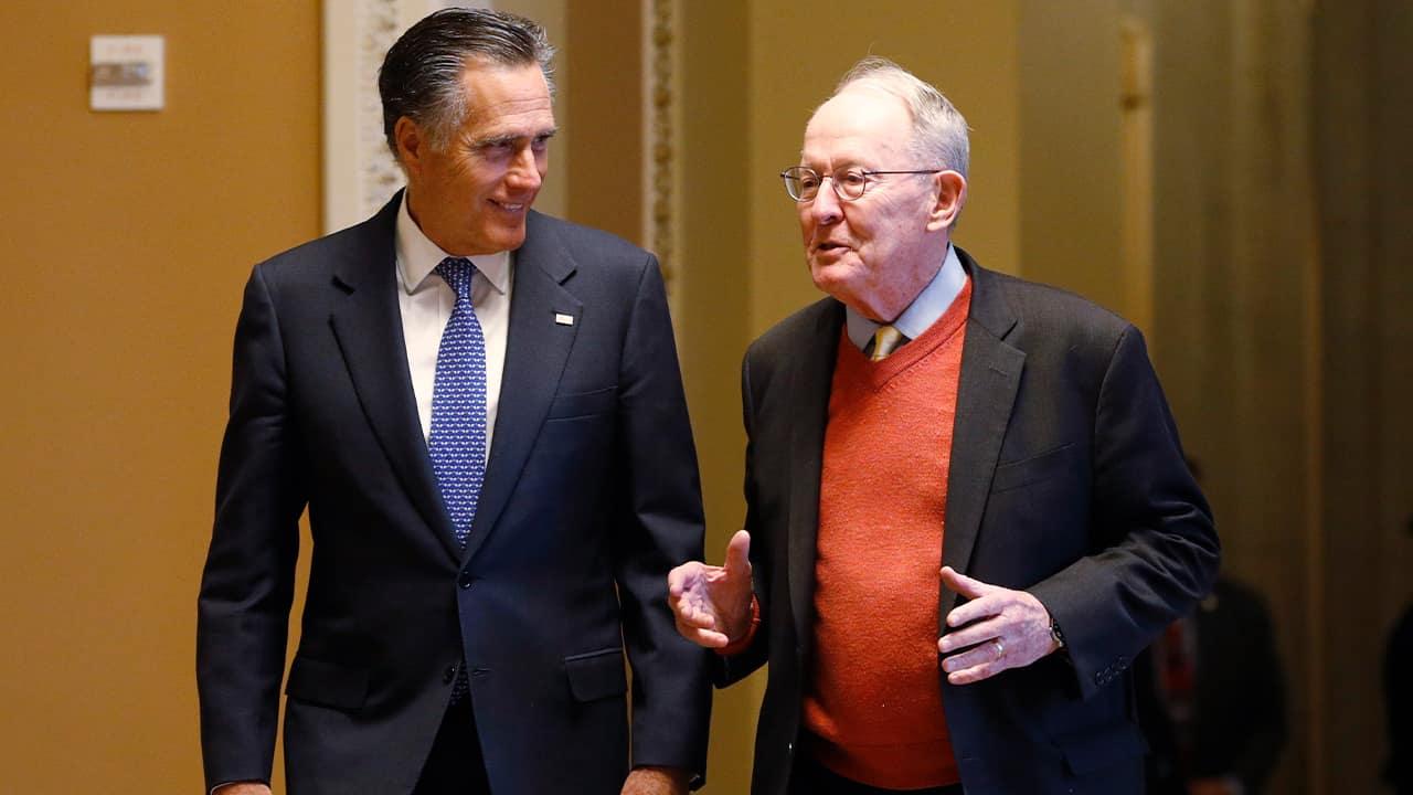 Photo of Sen. Mitt Romney, R-Utah, left, and Sen.m Lamar Alexander, R-Tenn.