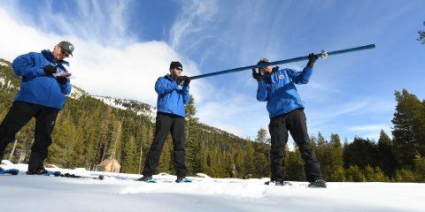 Photo of three snow survey members