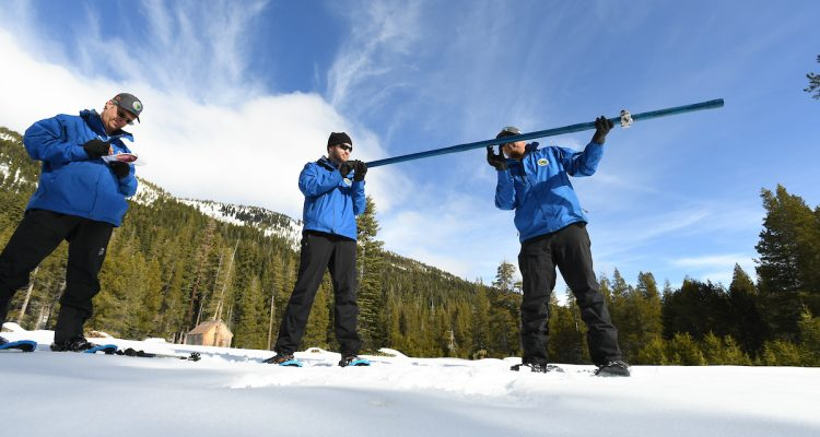 Photo of three snow survey members