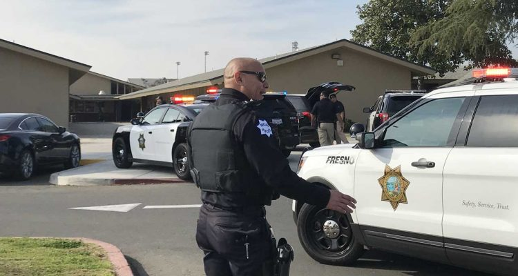 Photo of a Fresno Police officer at Bullard High School in Fresno, Ca.