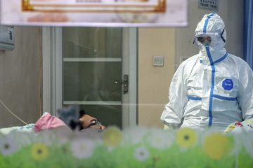 Photo of a doctor with to a patient in an isolation ward at a hospital in Wuhan in central China's Hubei Province