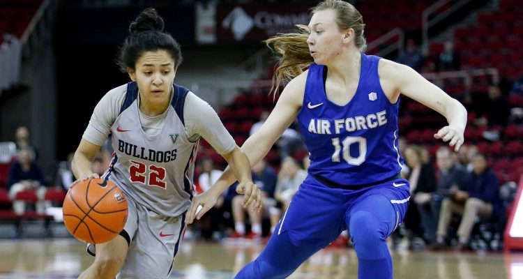 Photo of Bulldogs captain Aly Gamez dibbling past Air Force's Kamri Heath