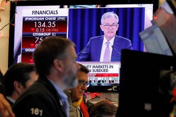 Photo of Jerome Powell on a television at the New York Stock Exchange