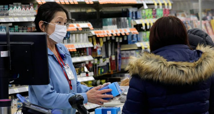 Photo of a sales clerk at a pharmacy in Chicago