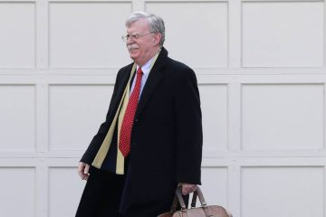 Photo of John Bolton leaving his house