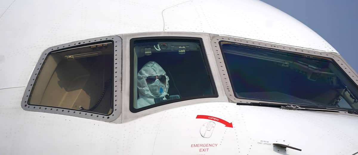 Photo of a pilot wearing a protective suit parking a cargo plane in Wuhan
