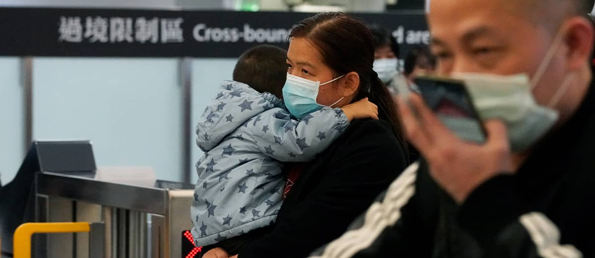 Photo of passengers wearing protective masks arriving at the high speed train staton in Hong Kong