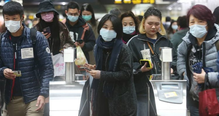 Photo of people wearing face masks at a metro station in Taipei, Taiwan