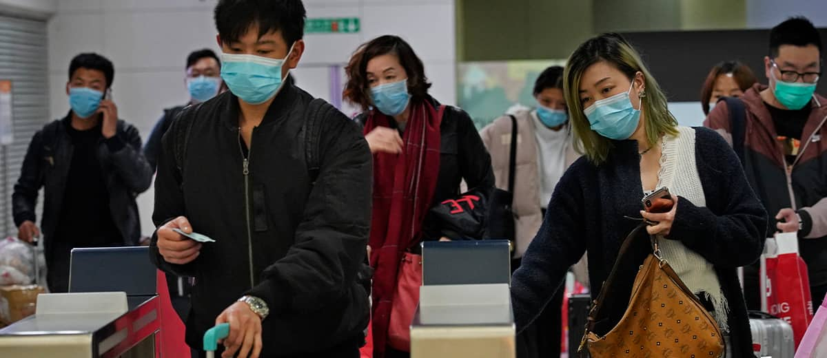 Photo of passengers wearing protective face masks arriving at the high speed train station in Hong Kong