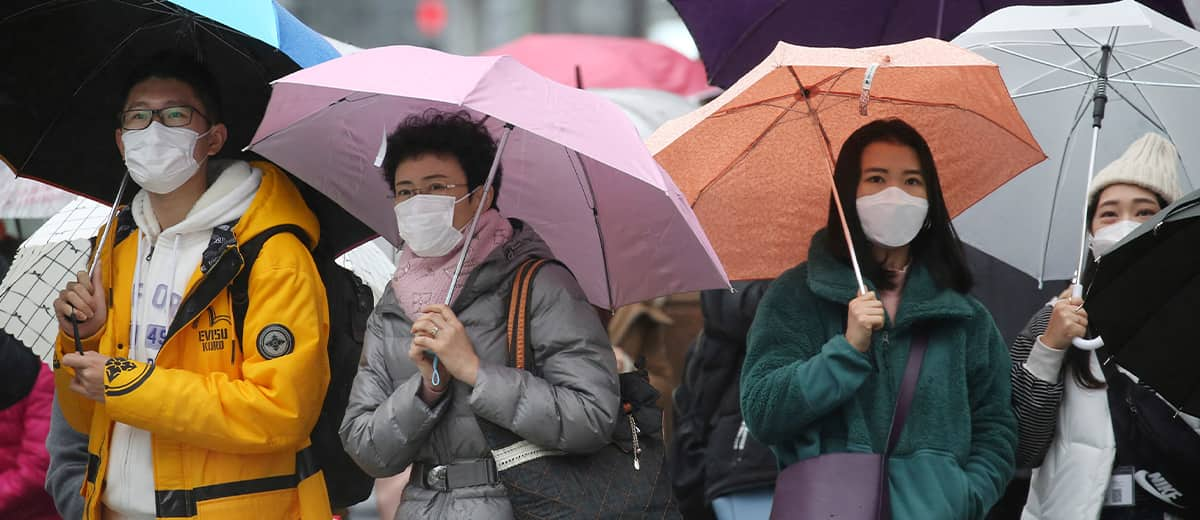 Photo of people wearing face masks at Ginza shopping district in Tokyo
