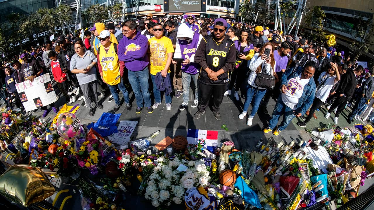 Photo of fan mourning the loss of Kobe Bryant at the Staples Center in Los Angeles