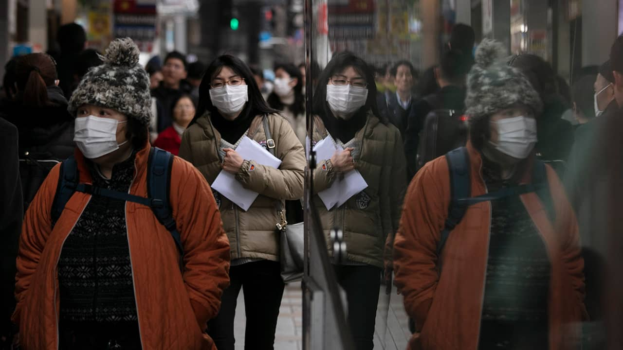 Photo of commuters wearing protective face masks