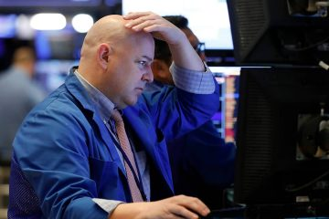 Photo of a trader working on the floor of the New York Stock Exchange