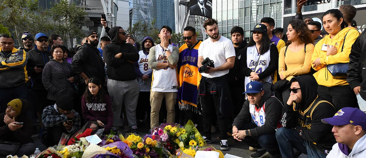 Photo of fans mourning at a Kobe Bryant memorial