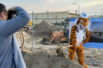 Photo of the Reedley College mascot shoveling dirt during a groundbreaking event