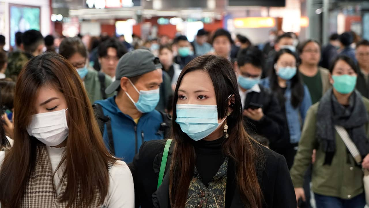 Photo of people wearing masks to prevent an outbreak of a new virus in China
