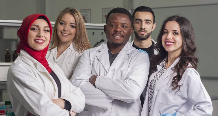 Photo of lab workers smiling
