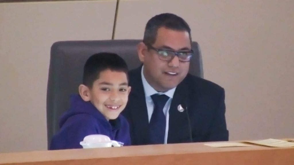 Photo of Councilman Miguel Arias and his son