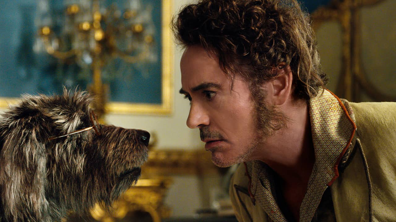 """Photo of Dr. John Dolittle, portrayed by Robert Downey Jr., right, with Jip, voiced by Tom Holland, in a scene from """"Dolittle."""""""