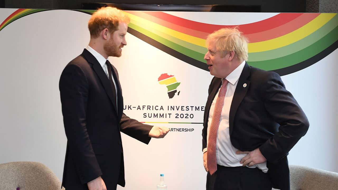 Photo of Britain's Prince Harry and Prime Minister Boris Johnson