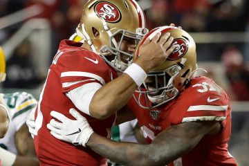 Photo of San Francisco 49ers running back Raheem Mostert and quarterback Jimmy Garoppolo