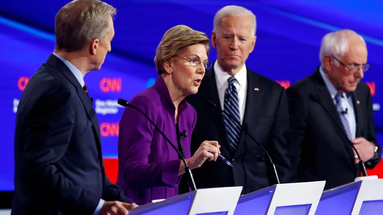 Photo of Democratic presidential candidate Sen. Elizabeth Warren, D-Mass., second from left, speaks as fellow candidates businessman Tom Steyer, left, former Vice President Joe Biden and Sen. Bernie Sanders, I-Vt., right, listen