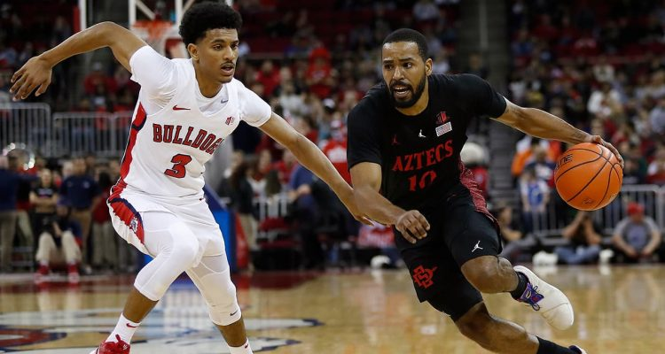 Photo of Fresno State's Jarred Hyder and San Diego State's KJ Feagin in game action