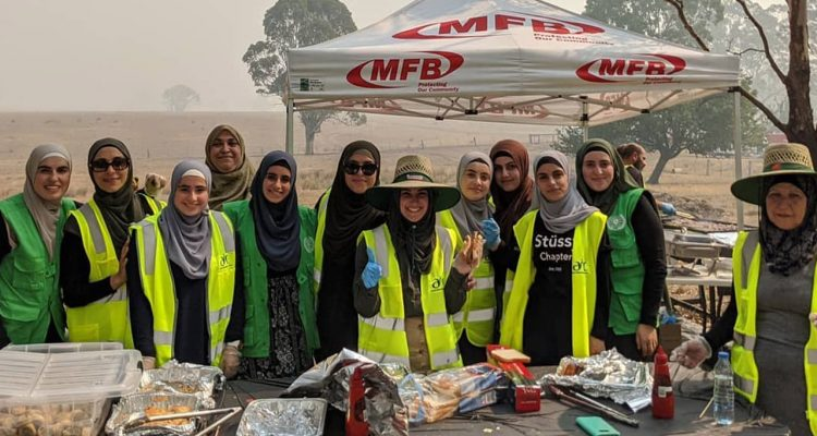 Photo of women providing meals to Australian firefighters