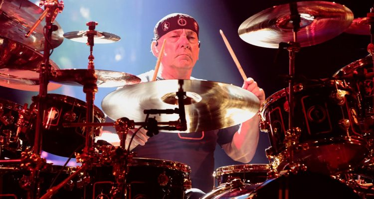 Photo of Neil Peart of the band Rush performing in concert