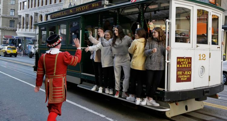 Photo of Tom Sweeney greeting trolly riders in San Francisco