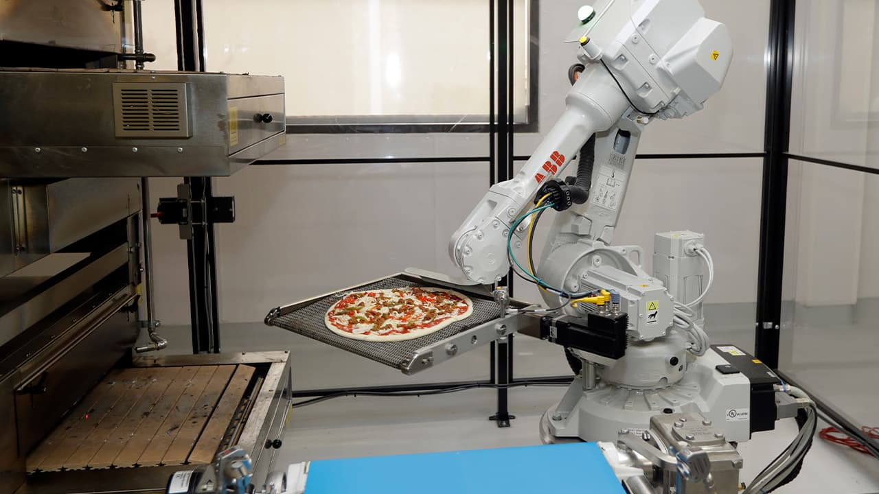 Photo of a pizza making robot