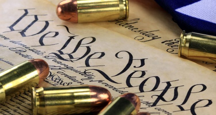 Montage of Constitution and gold bullets signifying the Second Amerndment