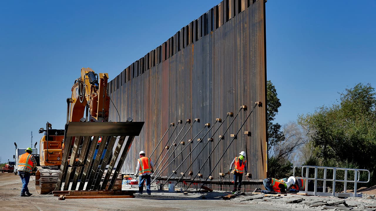 Photo of government contractors working on a section of the Pentagon-funded border wall
