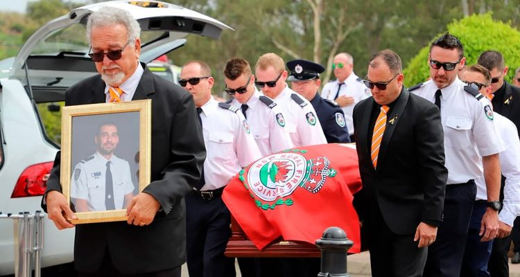 Photo of New South Wales Rural Fire Service crew members from Horsley Park RFS carrying the casket of Andrew O'Dwyer