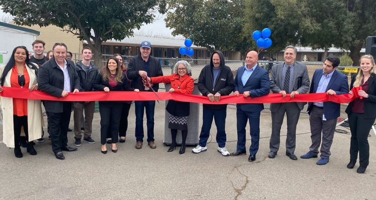 Photo of ribbon cutting for the RH Community Builders Winter Warming Shelter