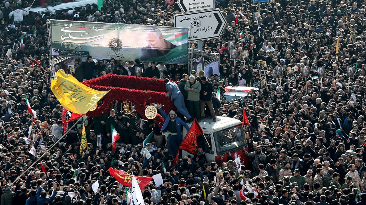Photo of mourners attending a funeral ceremony for Iranian Gen. Qassem Soleimani