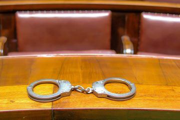 Photo of handcuffs on a court bench