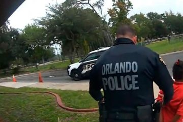 Photo of Orlando police officer Dennis Turner arresting a 6 year old girl