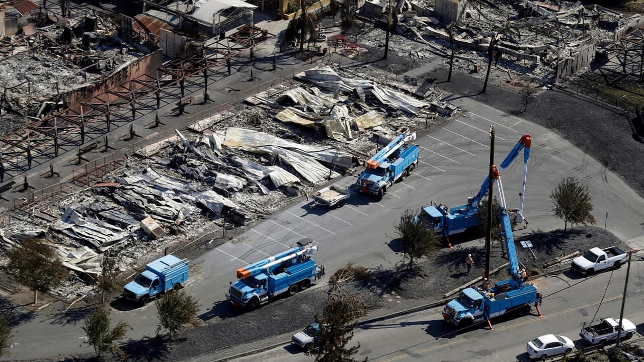 Photo of PG&E crew work on restoring power lines in Santa Rosa, Calif.