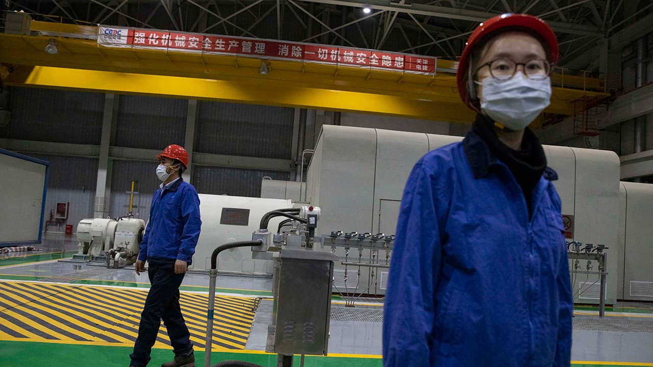 Photo of workers at a power plant in Beijing