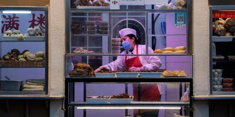 Photo of a chef working near a food display in Beijing