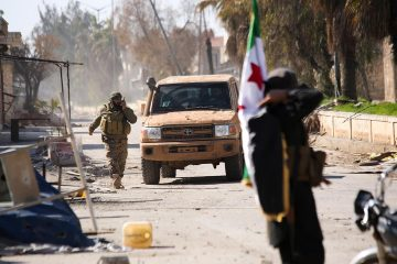 Photo of Syrian rebels entering the town of Saraqeb, in Idlib province, Syria